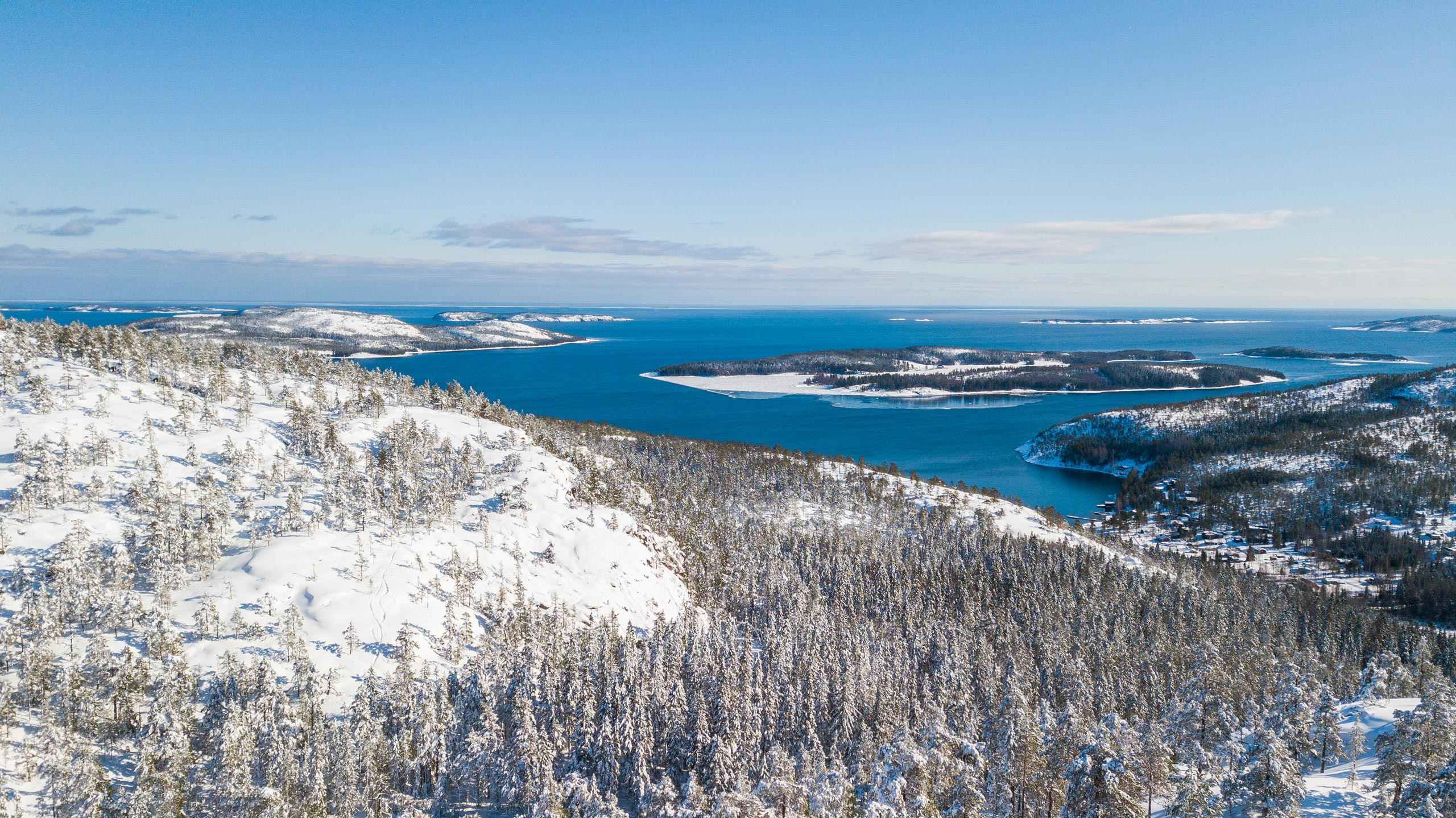 Hummelvik bay and some islands in the High Coast photographed from air in winter.